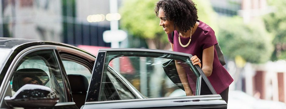 business-woman_entering_car_hero_laptop